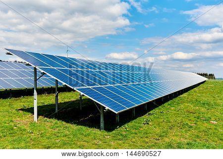 Solar panels on a green field.Western Europe