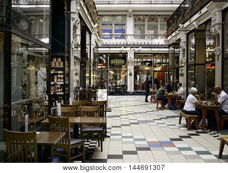 Deansgate, Manchester, England - August 23rd, 2016: Victorian Shopping Arcade built 1871
