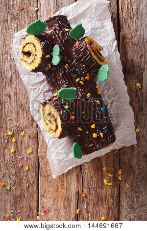 Christmas Yule Log, Buche De Noel, Chocolate Cake Closeup. Vertical Top View