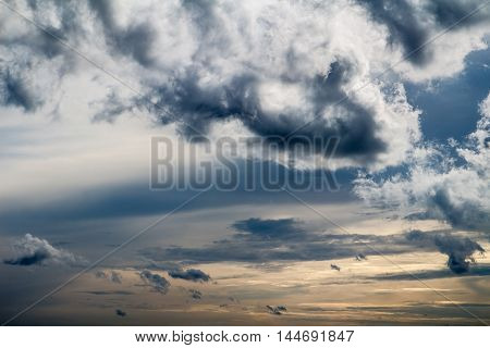 Dramatic, cloudy, stormy clouds, gray and yellow