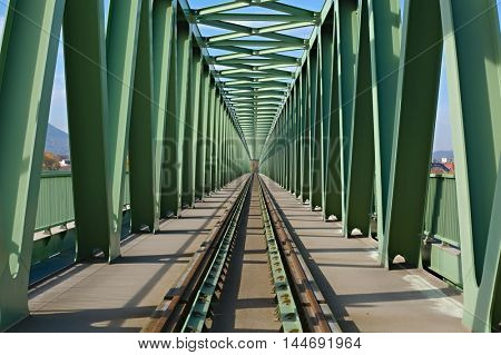 Railway bridge with steel grid structure