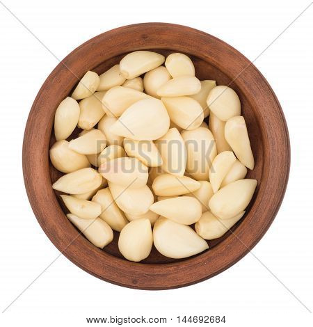 Garlic cloves in bowl from top including clipping path. Top view.