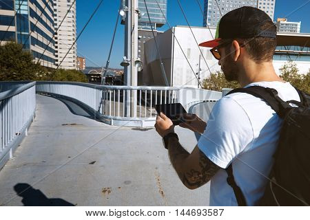 Tourist On A Bridge Looking For Right Way