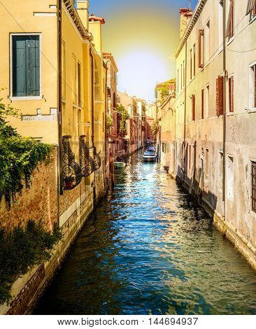 Gondolas or boats on water canal in beautiful town Venice