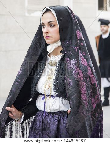CAGLIARI, ITALY - May 1, 2013: 357 ^ Religious Procession of Sant'Efisio - Sardinia - bela portrait of a girl in traditional Sardinian costume