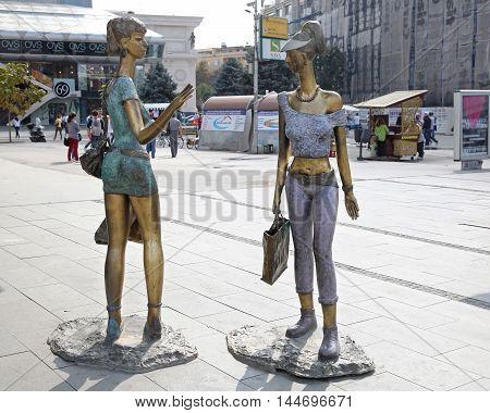 SKOPJE MACEDONIA - SEPTEMBER 17: Two Girls Sculpture in Skopje on SEPTEMBER 17 2012. Girlfriends Shoppers Statues at Macedonia Square in Skopje Macedonia.