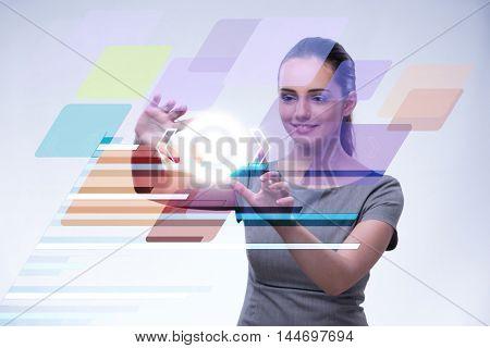 Businesswoman pressing virtual buttons in futuristic concept