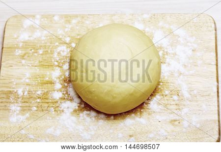 Cooking concept - Perfect dough ball on wooden  board