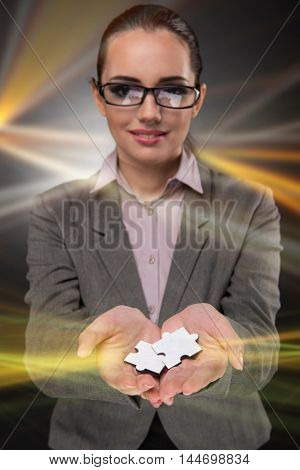 Businesswoman in business concept with puzzle piece