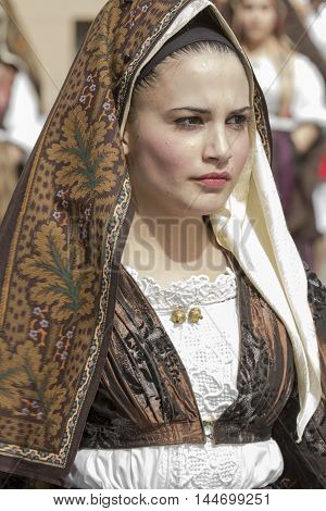 CAGLIARI, ITALY - May 1, 2014: Religious Procession of Sant'Efisio - Sardinia - portrait of a beautiful girl in traditional Sardinian costume