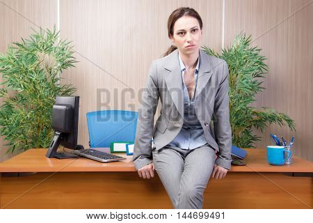 Woman under stress working in the office