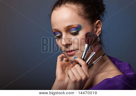 Young Woman With Brushes For Make-up.