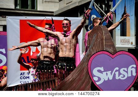 New York City - June 29 2014: Muscle boy gladiators riding on the Swish float at the 2014 Gay Pride Parade on Fifth Avenue