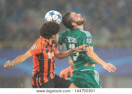 VIENNA, AUSTRIA - AUGUST 19, 2015: Taison (FC Shakhtar) and Thanos Petso (SK Rapid) fight for the ball in an UEFA Champions League qualification game.