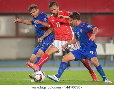 VIENNA, AUSTRIA - SEPTEMBER 5, 2015: Martin Harnik (Austria) and Georghe Andronic (Moldavia) fight for the ball in an European Championship qualification game.