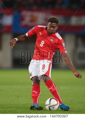 VIENNA, AUSTRIA - SEPTEMBER 5, 2015: David Alaba (Austria) kicks the ball in an European Championship qualification game.