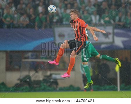 VIENNA, AUSTRIA - AUGUST 19, 2015: Olexandr Gladkiy (FC Shakhtar) and Thanos Petso (SK Rapid) fight for the ball in an UEFA Champions League qualification game.