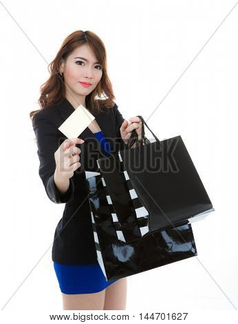Shopping woman holding bags isolated on white background