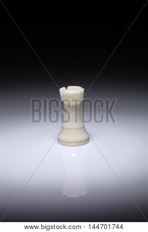 chess piece rook on the white background with spot light