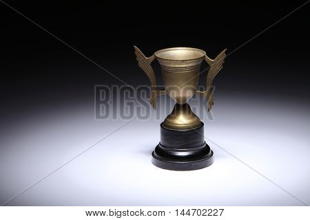 antique brass trophy on the white background
