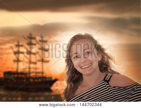 Portrait of a girl on the background of the ocean. Vintage style