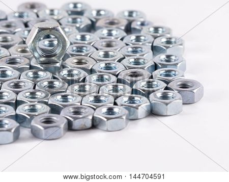 Bolts and Nuts on a white background. Bolts and Nuts used in construction. Tightening around the neck. Bolts and Nuts are descendants of mainly made of fine steel. Bolts and Nuts in isolate.