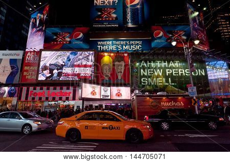 New York City USA - November 20 2011: Illuminated facades of Broadway with busy traffic and commercial atmosphere near Times Square in Midtown Manhattan is a symbol of New York City and the United States.