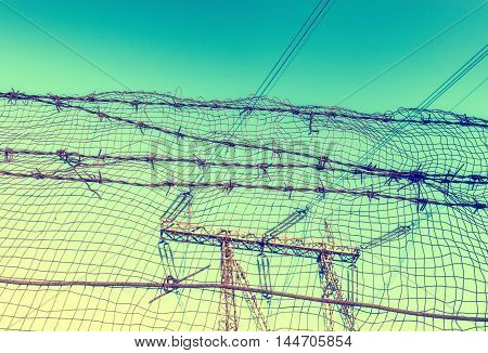 Barbed wire and lattice on the prison fence. Vintage image
