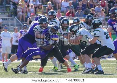 VIENNA, AUSTRIA - JULY 10, 2016: Tutanch Stevenson-Anthony-Maw (Vienna Vikings) runs with the ball in a game of the Austrian Football League.