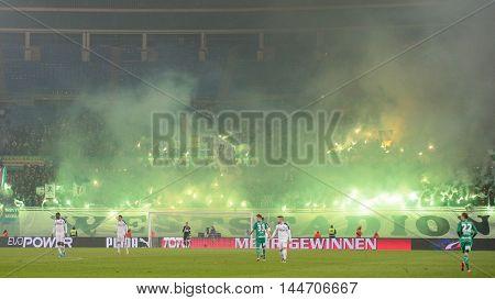 VIENNA, AUSTRIA - OCTOBER 28, 2015: Fans light fireworks during an Austrian Football Cup game.