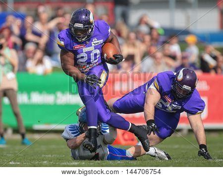 VIENNA, AUSTRIA - APRIL 3, 2016: slaam Amadu (Vienna Vikings) runs with the ball in a game of the Austrian Football League.