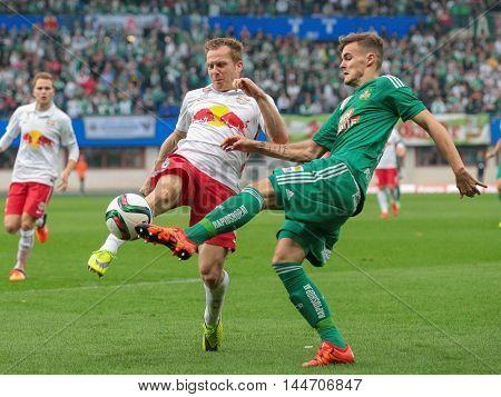 VIENNA, AUSTRIA - OCTOBER 4, 2015: Christian Schwegler (RB Salzburg) and Stefan Stangl (SK Rapid) fight for the ball in an Austrian Football League game.
