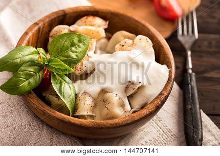 Meat dumplings with sour cream. Pelmeni russian national dish