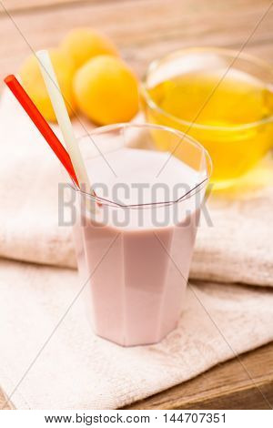Milk shake with straws, drinks and fruits