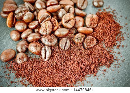 fresh roasted coffee beans on table close up