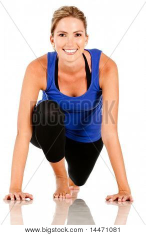 Sportive woman ready to run - isolated over a white background