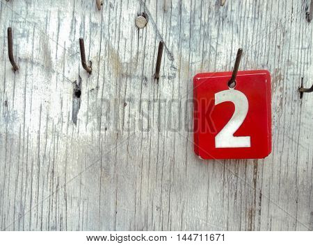 Numbers 2 on tags hanging in an old wooden, With place your text,  Retro color effect