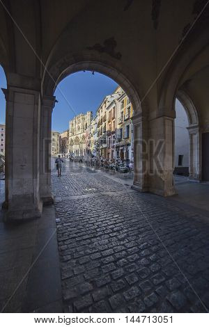 CUENCA SPAIN - August 24 2016: An arch leading to Plaza Mayor in Cuenca Spain