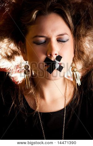 Silenced eccentric woman with tape over her mouth
