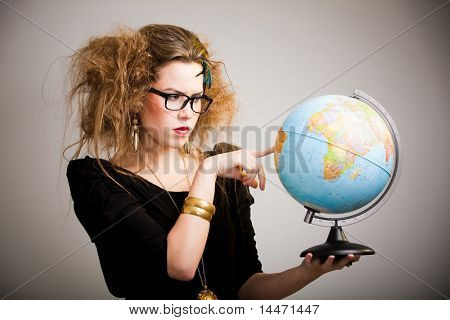 Crazy woman with messy hairdo holding a globe