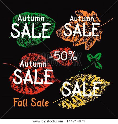 Autumn sale illustration. Leaves imprints on black background. Vector grunge leaves