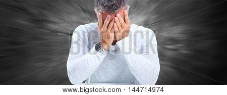 Man having a migraine headache.