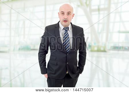 young business man surprised at the office