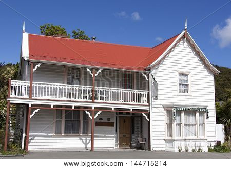 The historic wooden house on a main street of Akaroa resort town (New Zealand).
