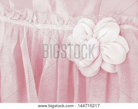 Soft focus and color retro effect/ Beautiful pink bow on flower-girl's dress