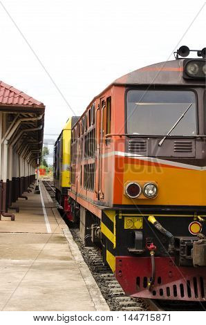 Old train parked in a railway station in Thailand.