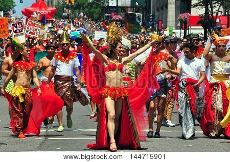 New York City - June 29 2014: Colorfully dressed in native clothing an Indonesian group marches in the 2014 Gay Pride Parade on Fifth Avenue *