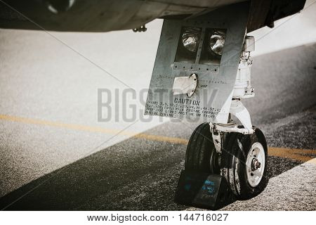 War aircraft plane undercarriage system close up.