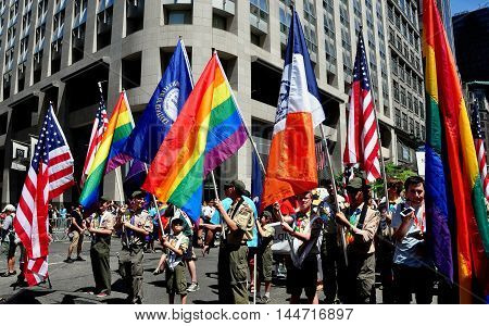 New York City - June 29 2014: Colour Guard carrying a variety of flags leads off the 2014 Gay Pride Parade on Fifth Avenue