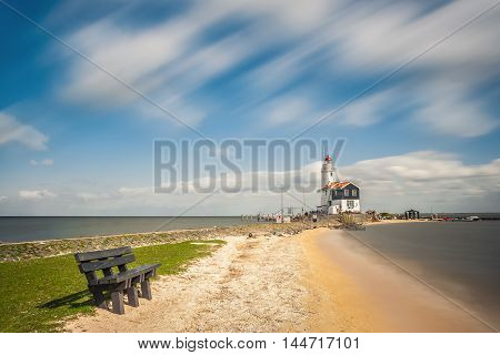 Landscape With Lighthouse On Bank